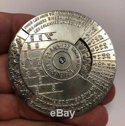 Très rare médaille à système Calendrier de 21 années CHRISTIAN DIOR